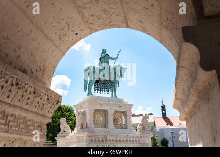 A bronze statue of king Stephen I mounted on a horse, erected in 1906, in the square between the Fisherman's Bastion - Stock Photo