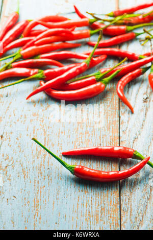 Hot red chili pepper  on a old blue color wooden table with place copy space for text. - Stock Photo