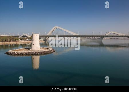 United Arab Emirates, Abu Dhabi, Sheikh Zayed Bridge, designed by Zaha Hadid and old Al Maqta Fort watchtower - Stock Photo