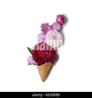Creative background with chrysanthemum and dahlia flowers in a ice cream cone. Floral border flat lay concept - Stock Photo