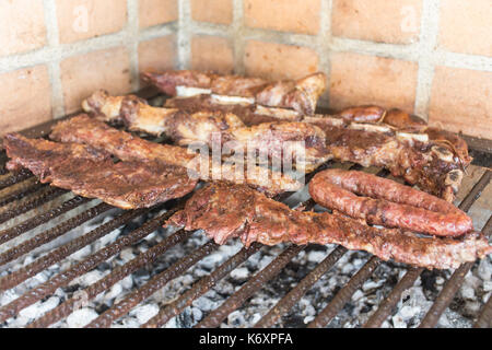 Traditional argentine barbecue or asado. Buenos Aires, Argentina - Stock Photo