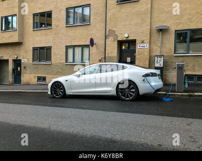 Electric car charging station in Oslo - Stock Photo