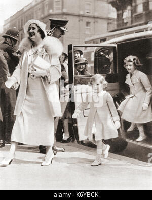 The Duchess of York arriving at the Royal Tournament at Olympia in 1935 with her daughters Princess Margaret, left - Stock Photo