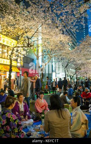 Japan, Tokyo, Nihombashi district, Tokyoites celebrating sakura, cherry blossom, through various festive events - Stock Photo