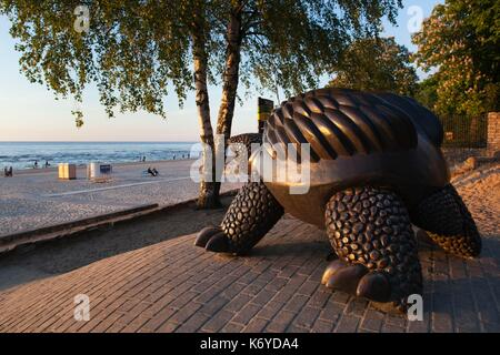 Latvia, Western Latvia, Riga Area, Jurmala, Majori Village, Majori Beach turtle statue, sunset - Stock Photo
