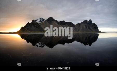Iceland, Stokksnes, Vestrahorn mountain mirrors in the waters of the Stokksnes bay - Stock Photo