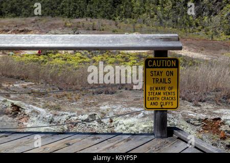 Warning sign about the danger one can encounter along the Sulphur Banks trail, nailed to an old wooden bench. located - Stock Photo