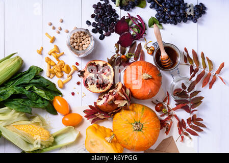 Variety of fresh colorful produce, fruits and vegetables arranged on white background. Healthy cooking concept. - Stock Photo