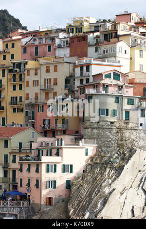 close up of the beautiful pastel colored houses of Manarola, Le Cinque Terre, Italy - Stock Photo