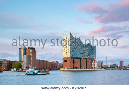 Germany, Hamburg. Elbphilharmonie (Elbe Philharmonic Hall) concert hall on the Elbe River and buildings in the HafenCity - Stock Photo