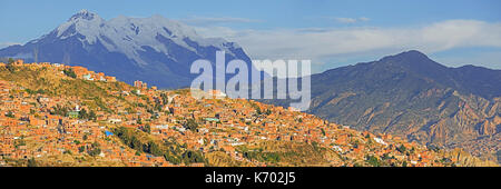 Mount Illimani, at 6.438 meter the highest mountain in the Cordillera Real, towering over the city La Paz, Bolivia - Stock Photo