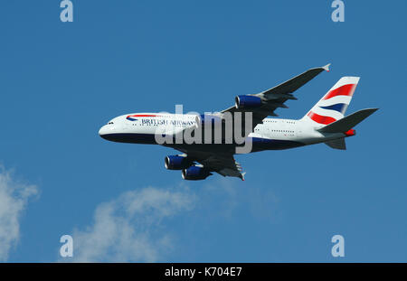British Airways A380 in Flight over Southwest London on Route to land at Heathrow Airport - Stock Photo
