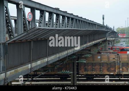 steel bridge over railway tracks - Stock Photo