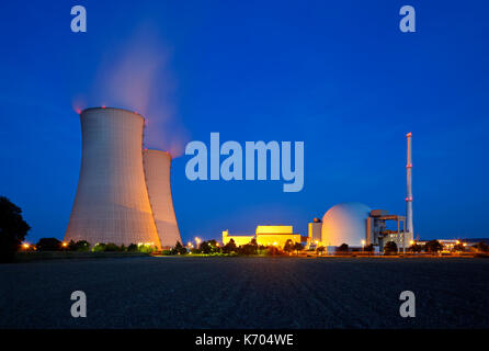 A nuclear power plant with night blue sky. - Stock Photo