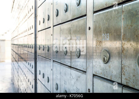 Wall of deposit safe boxes in a bank - Stock Photo