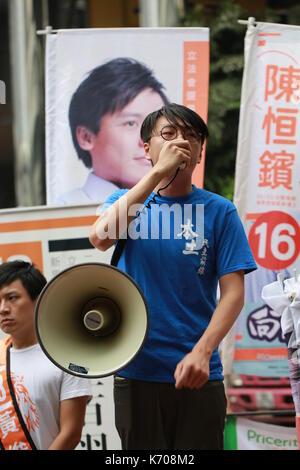 Edward Leung Tin kei, leader of Hong Kong Indigenous present in the street  in hong kong - Stock Photo