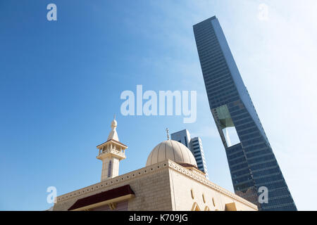 Mosque and Skyscraper in Kuwait - Stock Photo