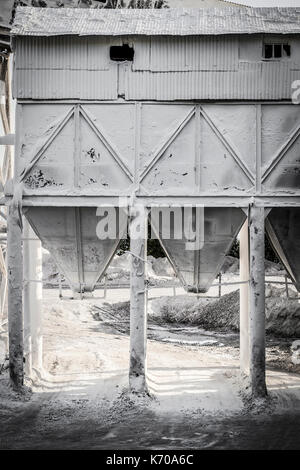 Place cement loading on trucks for shipment to the construction site. - Stock Photo
