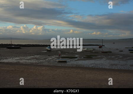 Stranded boats in Morecambe Bay at low tide - Stock Photo