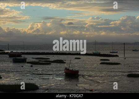 Stranded boats in Morecambe Bay at low tide - Stock Photo