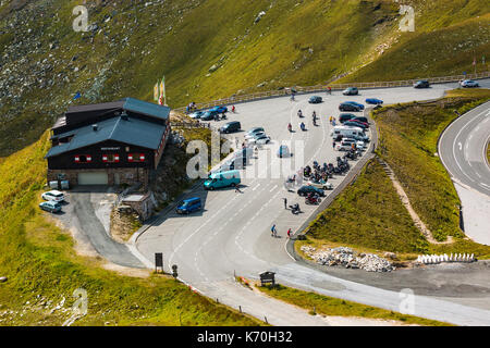 ALPS, AUSTRIA - 27.08.2017: Tourists at the mountain restaurant on the Grossglockner high alpine road in Austria - Stock Photo