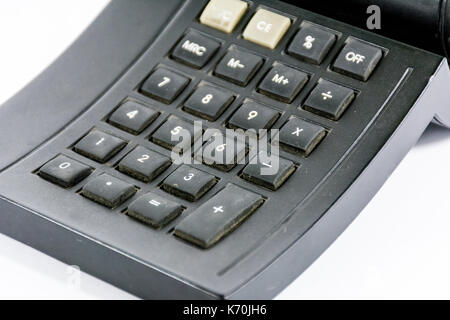 An old calculator black color with traces of use