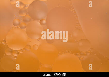 Abstract oil and water colourful peach pastel bubble background wallpaper - Stock Photo
