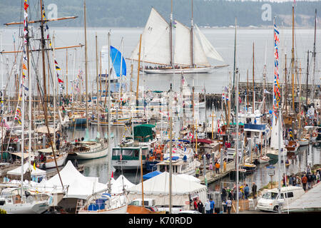 Wooden Boat Show Port Townsend, sailing boat in marina harbor, Point Hudson. With Adventuress schooner in background. - Stock Photo