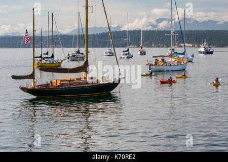 Wooden Boat Show Port Townsend, sailing boat at anchor in bay near Point Hudson. - Stock Photo