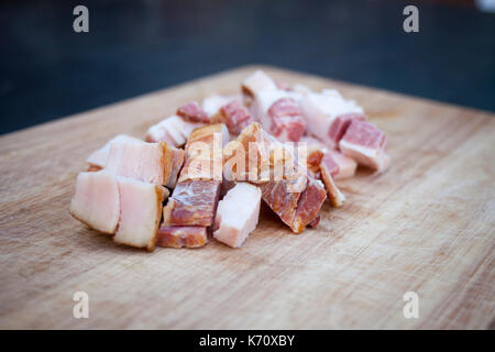 Fresh bacon on the wooden chopping board - Stock Photo
