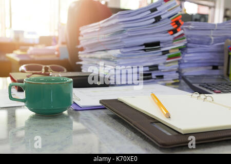 Concept of document workload, Pile of unfinished documents on office desk, Stack of business paper - Stock Photo