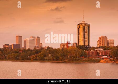 United States, Oklahoma, Tulsa, skyline from the Arkansas River, dusk - Stock Photo