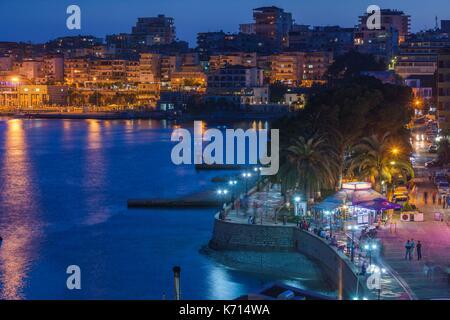 Albania, Albanian Riviera, Saranda, beachfront promenade, dusk - Stock Photo