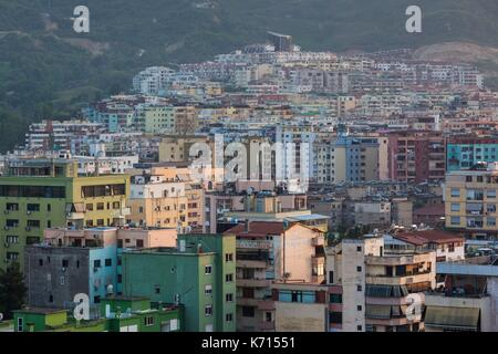 Albania, Tirana, elevated city view, dusk - Stock Photo