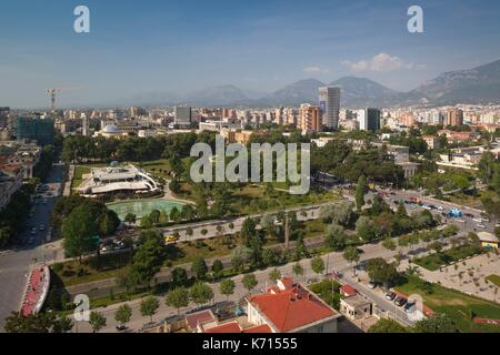 Albania, Tirana, elevated overview of Rinia Park and Taiwan Restaurant complex and Regency Casino - Stock Photo