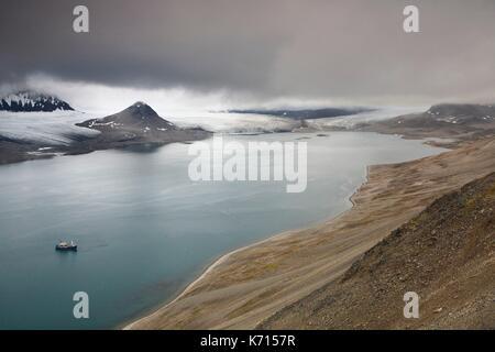 Norway, Svalbard, Spitzberg island, boat in Trygghamna bay - Stock Photo