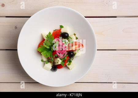 Salad with mozzarella, tomato and olives. Top view. - Stock Photo