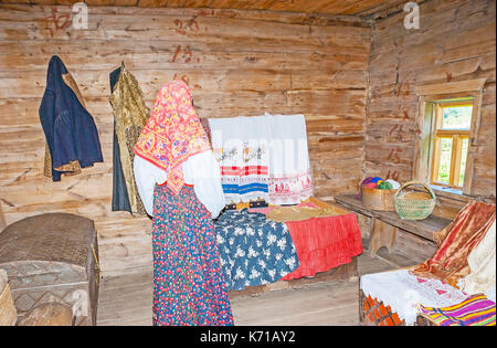 SUZDAL, RUSSIA - JULY 1, 2013: The ethnographic exhibition in old wooden izba of Museum of Wooden Architecture and - Stock Photo