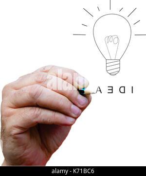 Hand drawing light bulb as an idea - Stock Photo