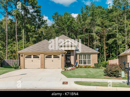 Exterior of new brick home or house in a suburban neighborhood in the suburbs of Montgomery Alabama, USA. - Stock Photo