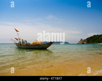 Beautiful view of a boat in the water in a sunny day, in Vietnam. Hoian is recognized as a World Heritage Site by - Stock Photo