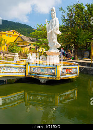 Beautiful view of a white stoned statue in the border of the pier, bin Hoian in Vietnam. Hoian is recognized as - Stock Photo