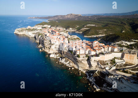 Aerial view of limestone cliffs, and the old town of Bonifacio, Corsica island, France - Stock Photo