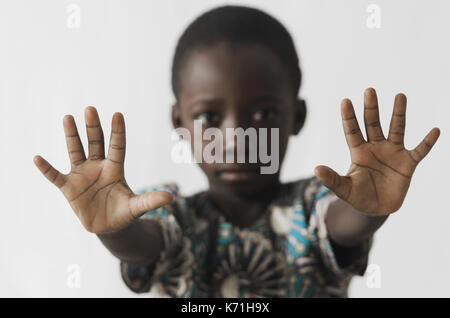 African boy STOP sign with his hands, isolated on white - Stock Photo