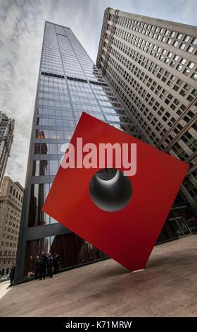 Isamu Noguchi's Iconic Red Cube at 140 Broadway in Lower Manhattan, New York City - Stock Photo