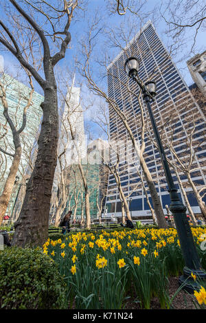 View of skyscrapers in Manhattan from Bryant Park, New York City - Stock Photo