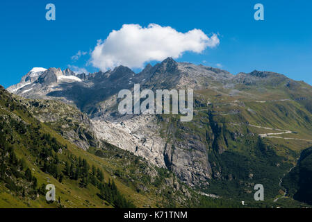 Furka pass road with Rhone glacier, view from Grimsel pass, Valais, Switzerland - Stock Photo