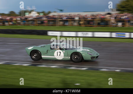 Ford GT40 racing in the Whitsun Trophy during the Sunday at Goodwood Revival 2017 Meeting, Goodwood race track, - Stock Photo