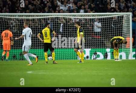 London, UK. 13th Sep, 2017. Dortmund's goalkeeper Roman Bürki (L) retrieves the ball from the back of the net after - Stock Photo
