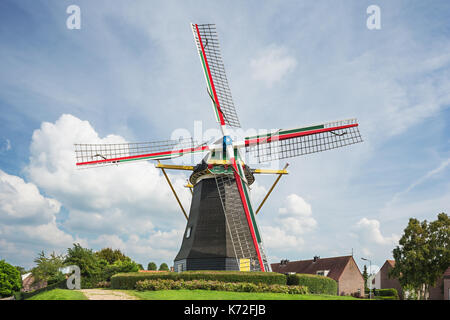 Colorful windmill Nooitgedacht in the middle of Arnemuiden - Stock Photo